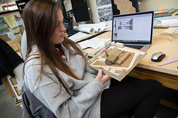 Architecture student working on her model
