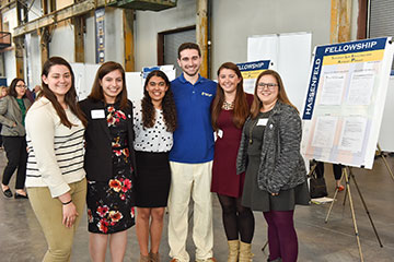 The inaugural group of Hassenfeld Fellows presented their work at the Community Engagement Celebration.
