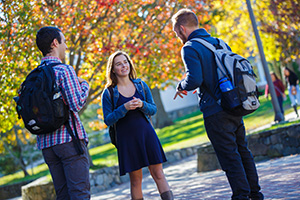Three students chatting
