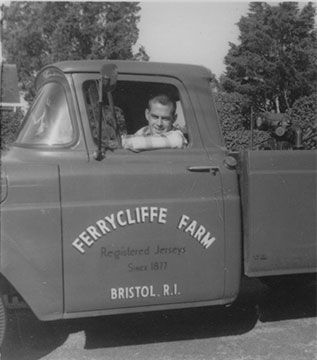 "Enzly ""Jimmy"" Ramsay driving a Ferrycliffe Farm truck."