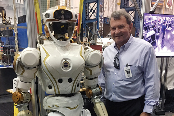 photo of RWU President-Designate Miaoulis with a robot