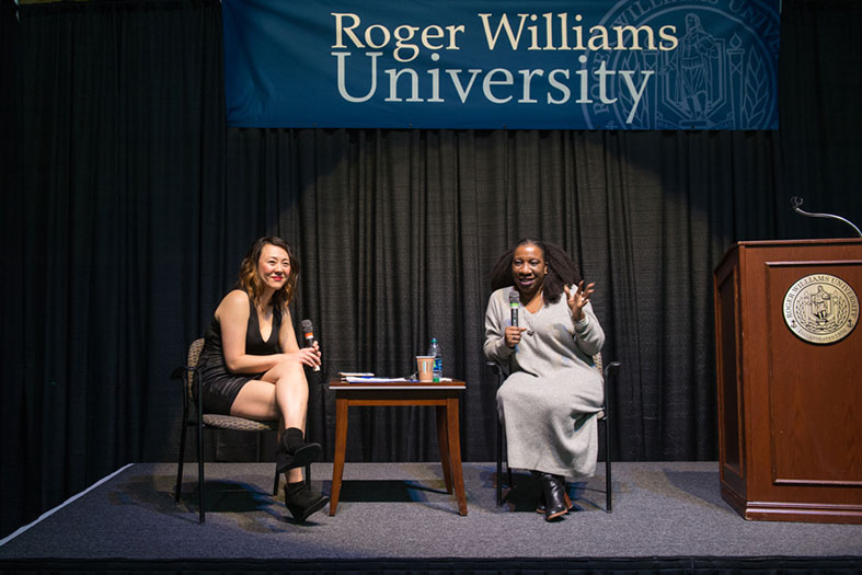 Tarana Burke converses with a moderator during her lecture.