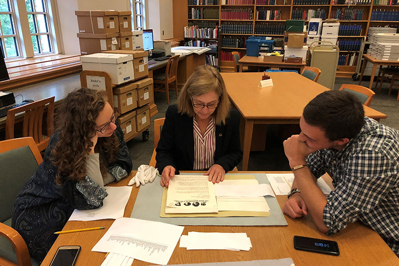 Students and staff examine artifacts in the Vonnegut archive.