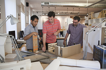 Architects reviewing models.