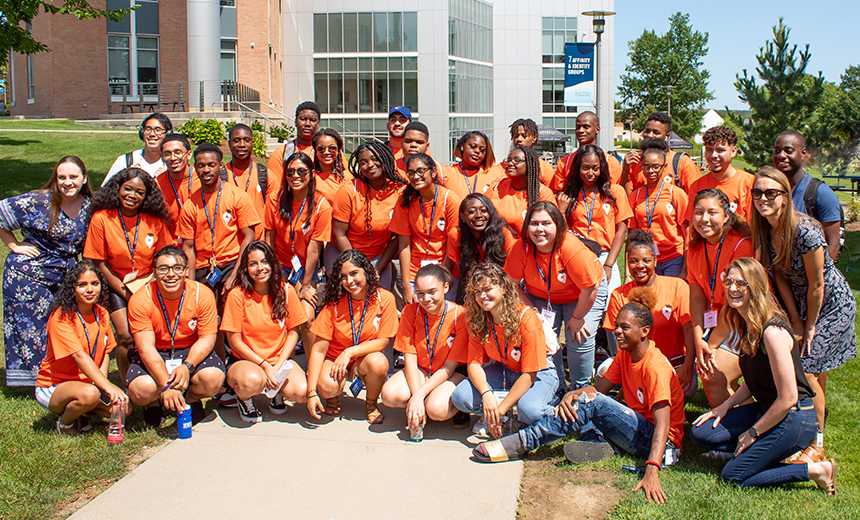 image of a group of students in matching orange t-shirts participating in RWU's College Map program