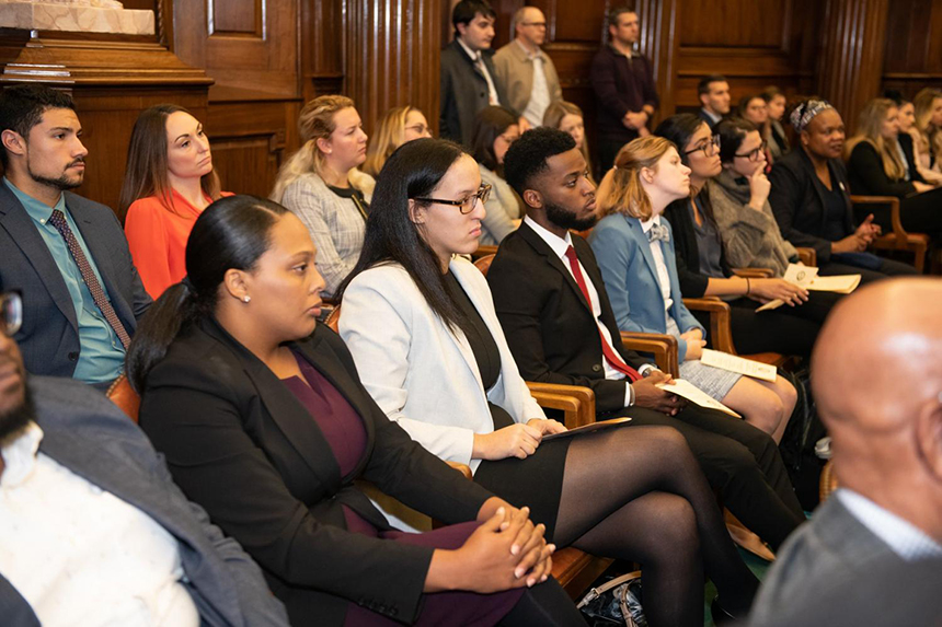 image of RWU Law students seated in a courtroom listening with great seriousness