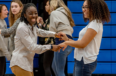 image of students dancing at Noche Latina Night hosted by Hispanic and Latina Student Association 2019