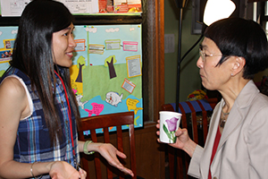 Student talking to a professor at an Intercultural Center event