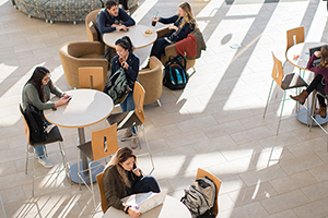 students sitting at tables in the Global Heritage Hall