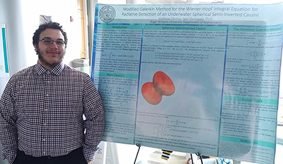 Students present poster at Student Academic Showcase and Honors event