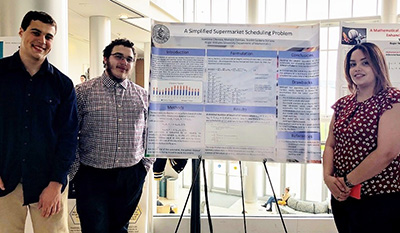 Student presents poster at Student Academic Showcase and Honors event
