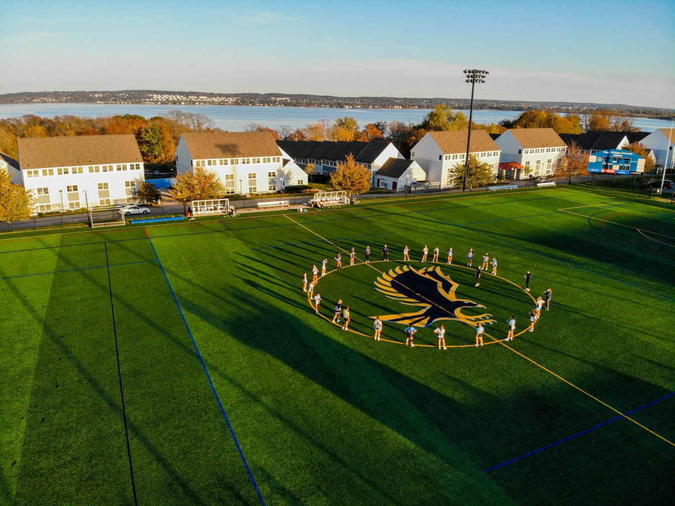 Women's lacrosse team groups up before practice