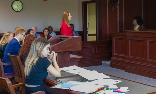 student questions witness during mock trial