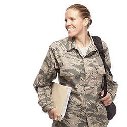 A woman in army fatigues holding a folder.