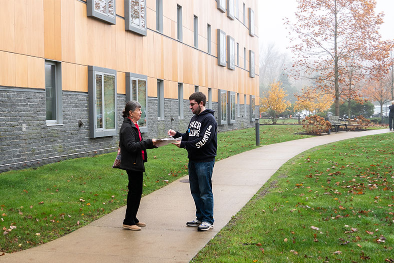 Student conducts voter exit poll on Election Day.