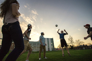 students playing volleyball