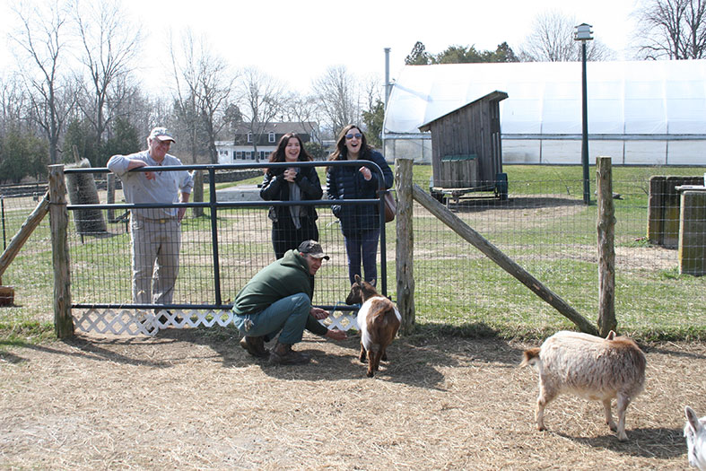 Journalism students observe news segment on goats.