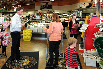 Students conduct market survey in grocery store.