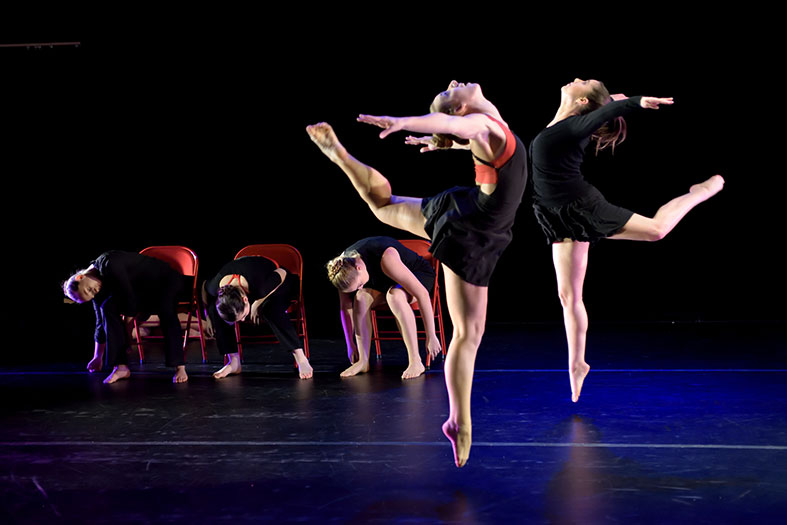 Students dancing in a performance