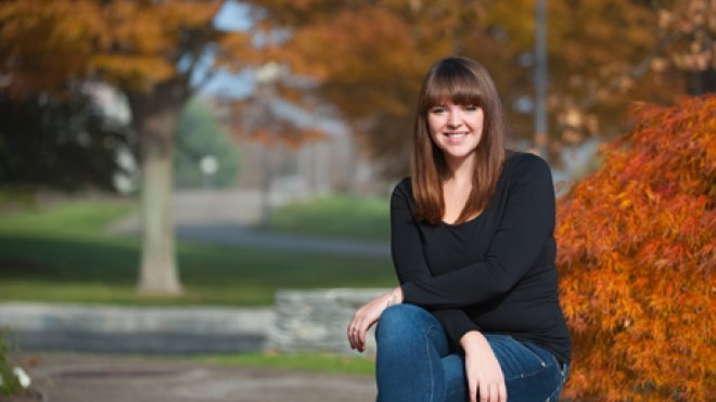 Student sits in the university quad.
