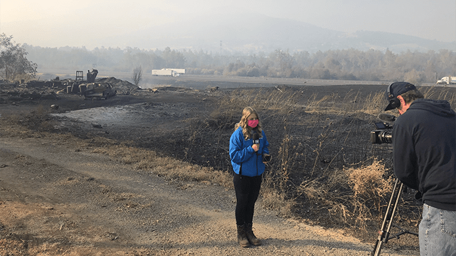 Journalism alumna reporting from the scene of an active fire in Oregon's wildfires.