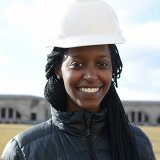 A headshot of Alexia Byusa wearing a hardhat