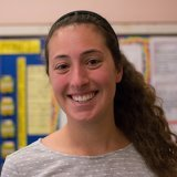 A headshot of Meghan Curran in a middle school classroom