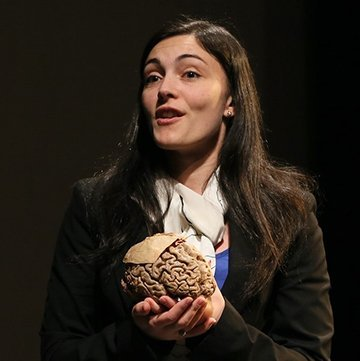 photo of Assistant Professor of Psychology Victoria Heimer-McGinn holding a model of a human brain