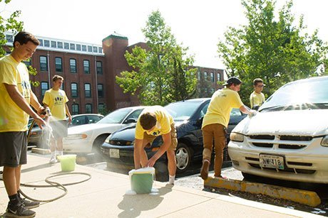 Students wash cars for residents of an independent living facility.