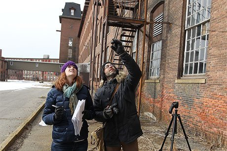 Historic preservation students examine unique characteristics of a former mill in Pawtucket.