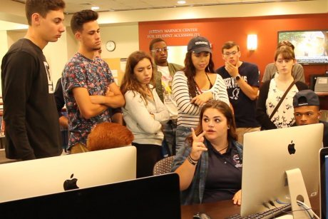 Emily Parratt shows first-year students the RWU Library