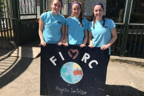 RWU Students hold FIMRC sign.