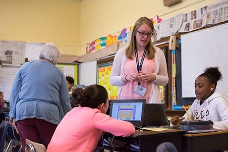 Elise Frank '17 works with students at George J. West Elementary School