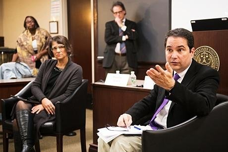 Law professors share their expert opinions during program.