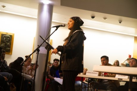 Student performs at microphone.