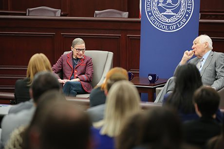 U.S. Supreme Court Justice Ruth Bader Ginsburg talks to 1st U.S. Circuit Court of Appeals Senior Judge Bruce M. Selya