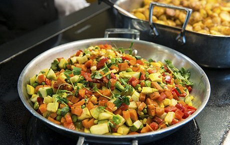 A healthful meal is prepared in the university dining commons.