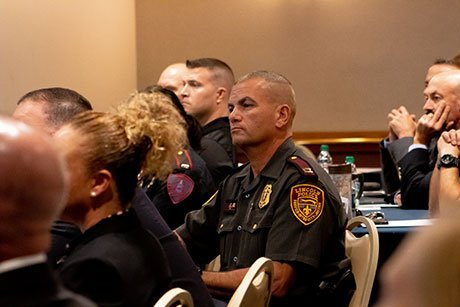 R.I. State Police members listen as the initiative is unveiled.