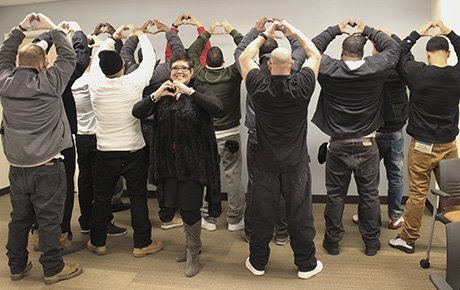 Inmates celebrate their graduation from a job-readiness program.