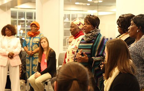 Women from a local refugee group talk to students about their experiences.