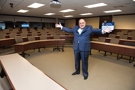 Professor Santoro stands inside the classroom dedicated to him.