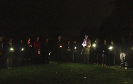 Students, faculty and staff gather to hold a candlelight vigil on campus.
