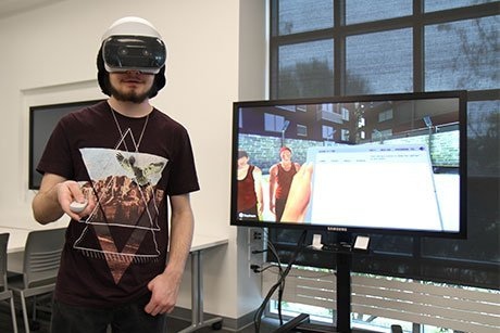 Student using virtual reality to take a science lab.