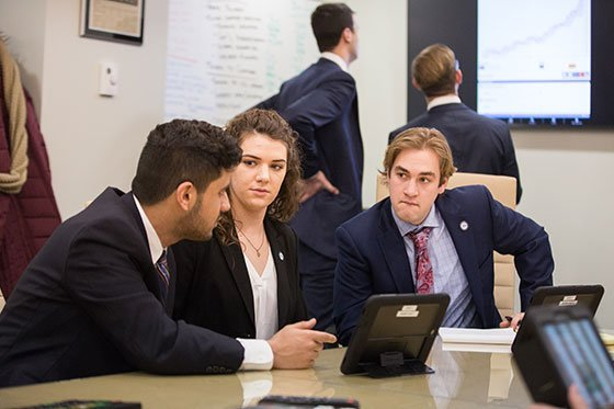 images of students in business attire conferring
