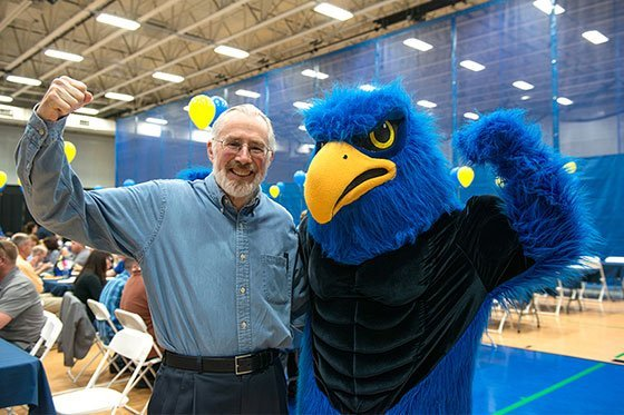 President Farish poses with Swoop, RWU's mascot.