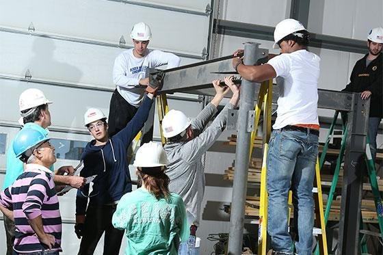 Students learn how to put up scaffolding.