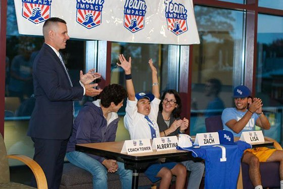 Young boy and his family celebrate becoming part of the RWU baseball team.