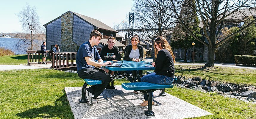 Students sitting at outdoor table