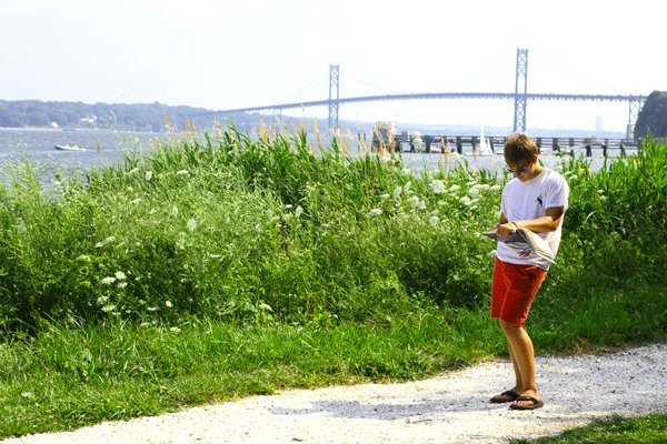 A student walking by the Bay