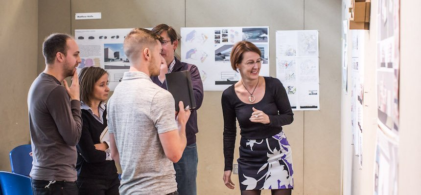 group of graduate students around architecture project